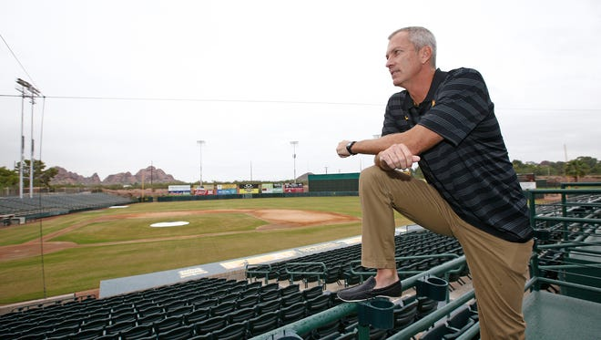 New baseball coach Tracy Smith looks over ASU's new baseball home at Phoenix Municipal Stadium.