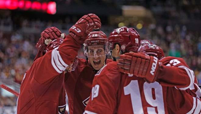 Coyotes' Michael Stone (26) celebrates with teammates after a goal from Oliver Ekman-Larsson in the second period at Gila River Arena in Glendale, AZ on April 4, 2015.