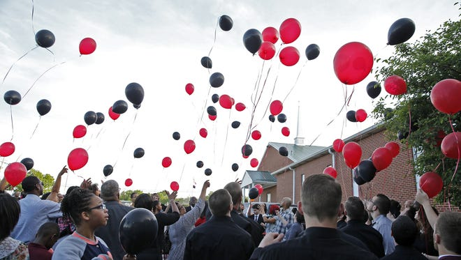 Family and friends pay their final condolences to 18-year-old Travis Dupree Liversgowdy during visitation and funeral services.