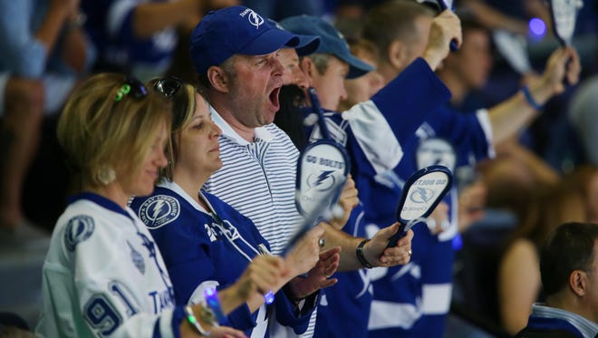Tampa Bay Lightning fans cheer on their team.