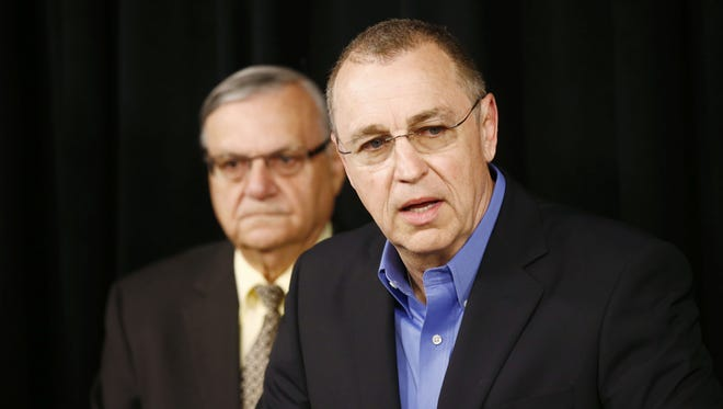 U.S. Rep. Matt Salmon (right) holds a press conference with Maricopa County Sheriff Joe Arpaio to introduce the Stop Catch and Release SCAR Act (Grant's Law) on Tuesday, June 30, 2015.