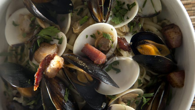 Linguine With Mussels, Clams and Black Truffle Bacon.
