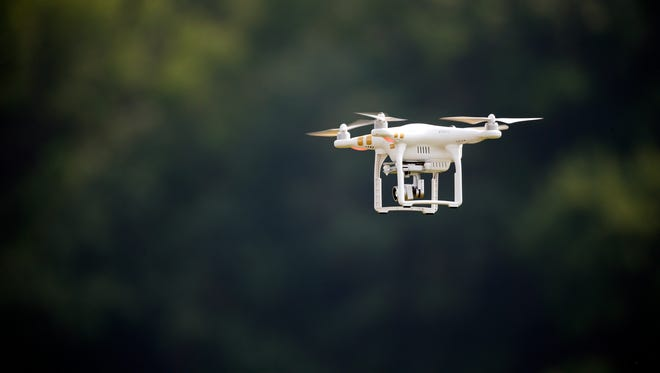 A DJI Phantom 3 drone is flown during a drone demonstration at a farm and winery. Walmart  petitioned FAA on Oct. 26, 2015 to test this type of drone for package delivery.