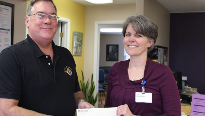 Tim Malloy of the Knights of Columbus in Mountain Home recently presented Diahanne Van Gulick, coordinator of the Mruk Family Education Center on Aging, with a donation check for $250 to support programs offered at the house.