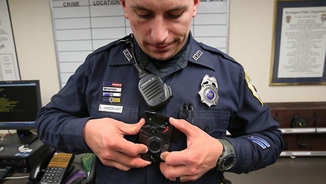 Brockport Police Officer Lucas VanDervort puts on his Taser Axon body camera as he starts his afternoon shift at the department Jan. 6.