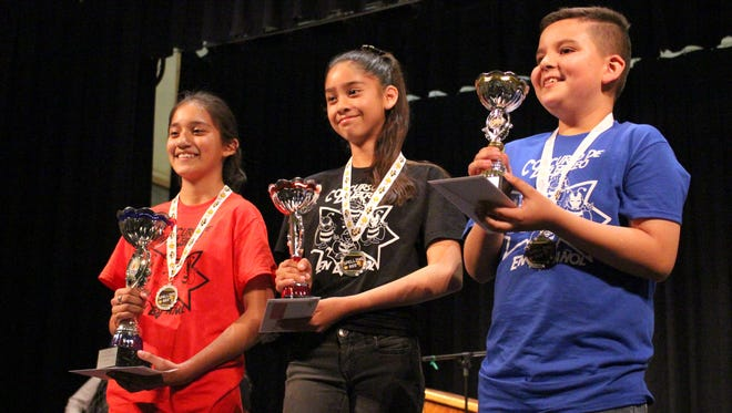 From left, are Yoshira Barragan, first place; Carmelita Coronado, second place; and Ivan Ruiz, third place.