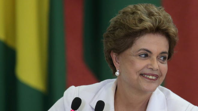 Brazil's President Dilma Rousseff smiles during the launching ceremony of the third stage of Minha Casa Minha Vida Program, at the Planalto Presidential Palace in Brasilia, Brazil, Wednesday, March 30, 2016.