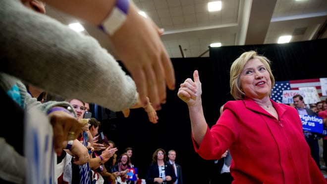 Democratic presidential candidate Hillary Clinton, center, arrives to speak at a get out the vote event at Transylvania University in Lexington, Ky., Monday, May 16, 2016. (AP Photo/Andrew Harnik)