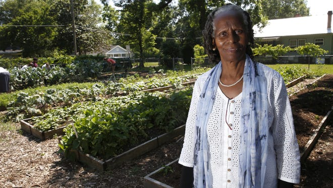 Miaisha Mitchell, co-founder of IGrow, a Frenchtown community garden set up to foster local youth volunteer development and fresh produce for an area considered to be a food desert.