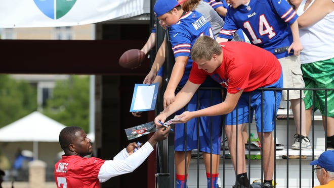 Bills rookie quarterback Cardle Jones signs autographs on the first day of training camp at St. John Fisher College.