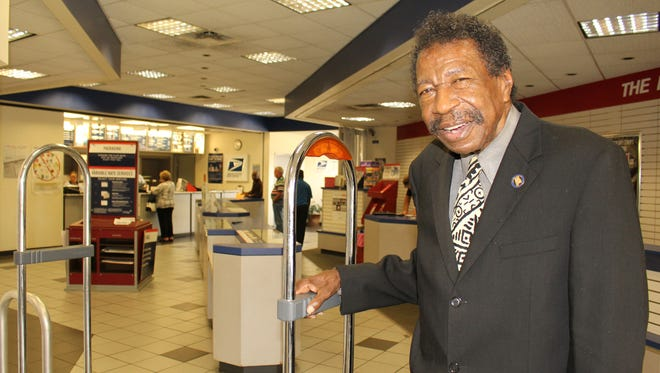 "Civil rights trailblazer Bruce Boynton ""inspects"" Selma's post office that will be named in honor of his late mother, Amelia Boynton Robinson."