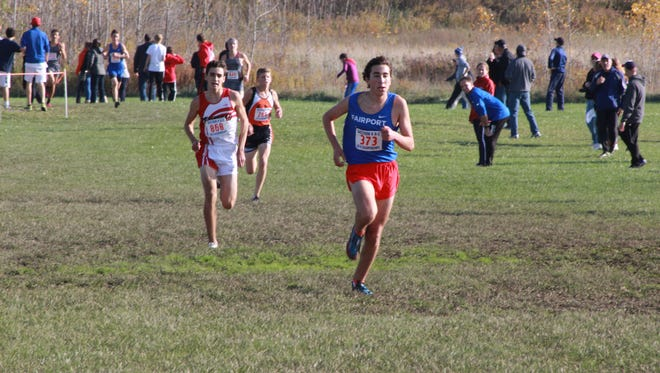 Majd Rouhana leads Penfield's Tyler Senall near the finish of the 2016 Section V Class A race at Wayne Central.