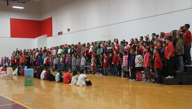 Loving Elementary School students perform about eight holiday and non-holiday songs.