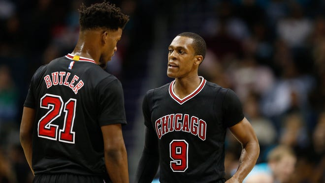 Chicago Bulls guard Rajon Rondo (9) talks with forward Jimmy Butler (21) in the second half at Spectrum Center.