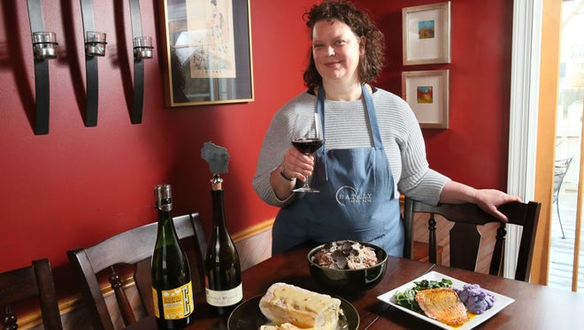 Great Host Jennifer Stearns prepared (from left) Seafood Terrine with Champagne Beurre Blanc Sauce,  Red Wine Risotto with shaved black truffles and seared salmon topped with carrot-curry reduction, with seared spinach and horseradish purple potatoes. And there is always wine.