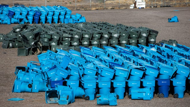 The city of Phoenix recycle and garbage bins at the Phoenix solid waste transfer station on Sept. 9, 2015.