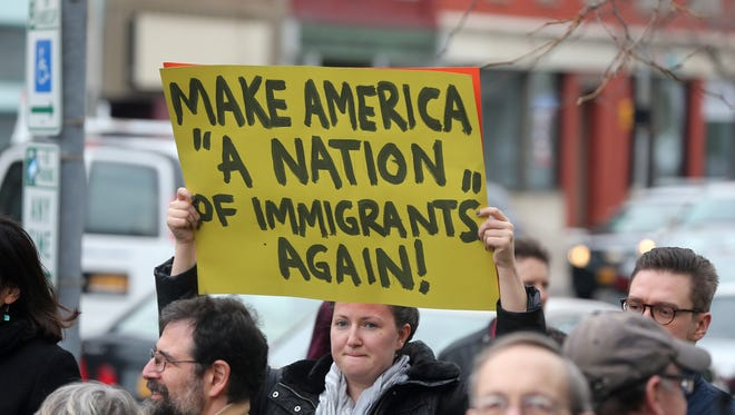 Megan Smith of Rochester takes part in a rally outside the Federal Building to protest government treatment of immigrants and their families.