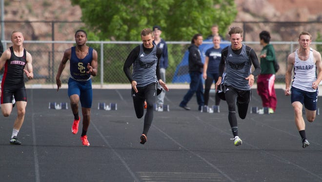Desert Hills' Bradley Earl (right) and Snow Canyon's Keivontae Washington (left) compete in the Region 9 track meet at Desert Hills High School Saturday, April 8, 2017.