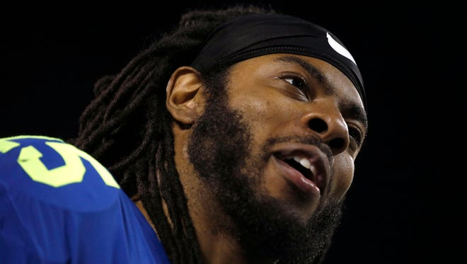 Seahawks cornerback Richard Sherman reported to the team's training facility for voluntary workouts Monday.