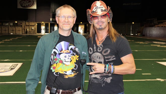 Scott Boesch, event coordinator for PMI Entertainment Group, left, gave Bret Michaels a tour of Brown County Veterans Memorial Arena before Poison's sold-out show with Def Leppard at the Resch Center next door.