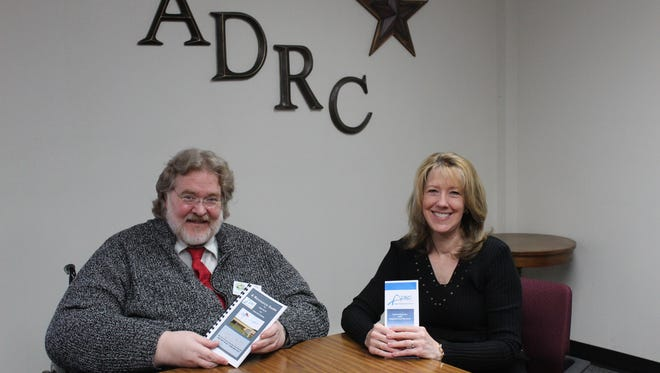 Dale Deterding, Aging Supervisor, and Marie Seger, Aging & Disability Resource Center of Sheboygan County Supervisor, review resource materials available free to Sheboygan County residents at the ADRC, 650 Forest Ave., Sheboygan Falls.