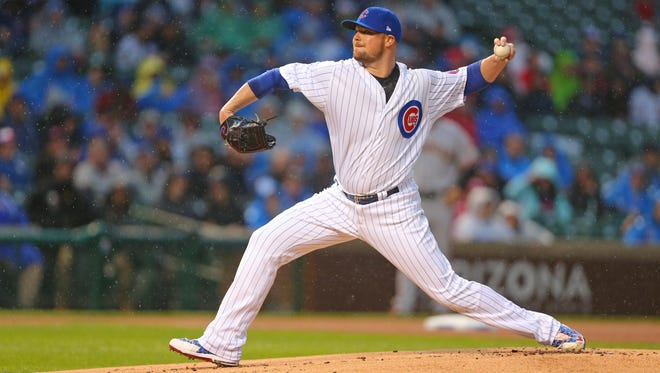 Cubs starting pitcher Jon Lester delivers a pitch during the first inning against the Giants at Wrigley Field.