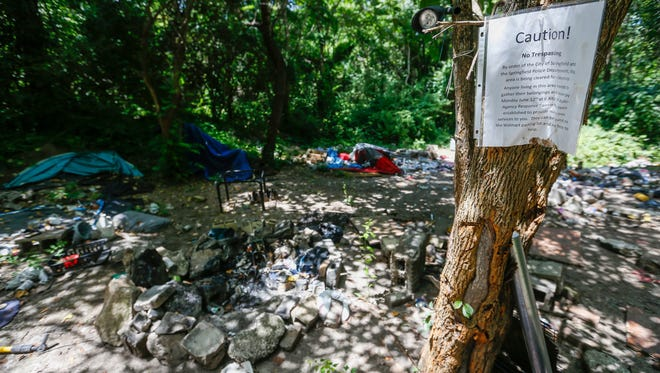 Piles of concrete, asphalt, bricks and steel Rebar are hindering efforts to clean up the former homeless camp located near the intersection of Kearney and Glenstone.