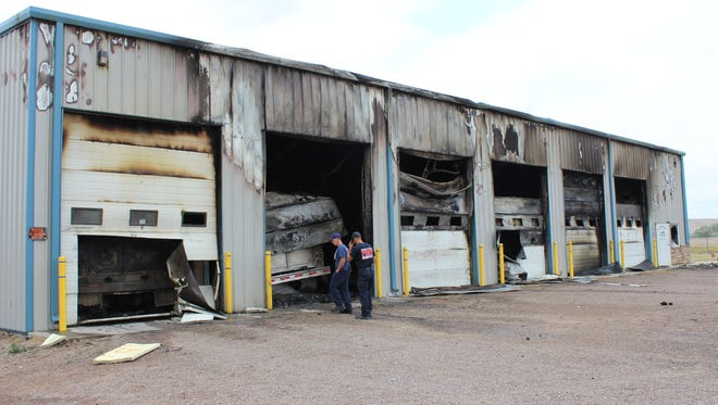 Great Falls Fire Rescue personnel inspect the damage to the Prairie Water Company building Wednesday afternoon
