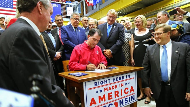 Gov. Scott Walker signs the Foxconn bill into law at Gateway Technical College's S.C. Johnson iMET Center in Sturtevant.