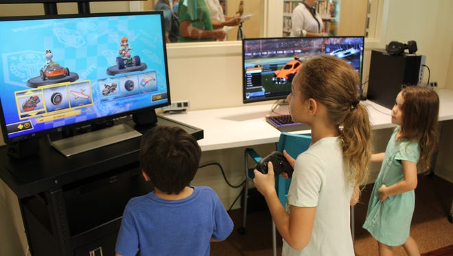 Teens and children will love the gaming section of the new Paula A. Lewis Library.