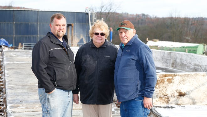 From left, Brian, Pat & Doug Aukema inside the former site of their dairy barn in Chenango Forks on Monday, November 20, 2017.  The Aukema's dairy barn was destroyed by a fire on October 10th.