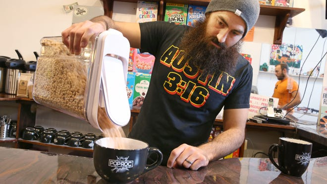 Nick Andolina pours a bowl of cereal at POP ROC on East Ave. in Rochester Wednesday, April 4, 2018.