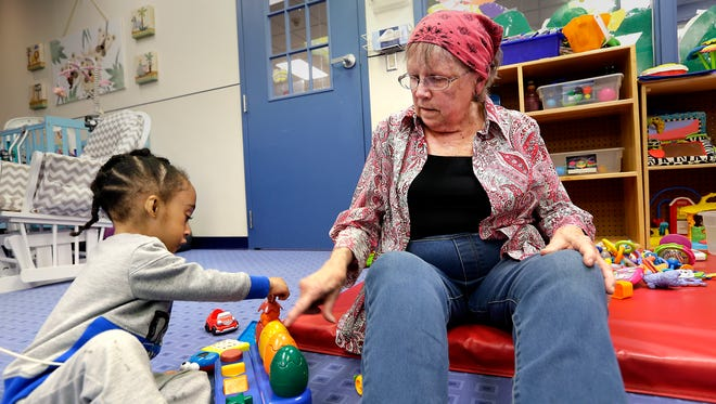 Bonnie Bruhn, a retired nurse who volunteers in the Special Care Nursery at Penfield Children's Center, plays with Jaiden, a client in the program that specializes in taking care of extremely disabled infants and toddlers. Penfield Children's Center was awarded a $35,000 grant in 2020 through the Gannett Foundation's A Community Thrives program.