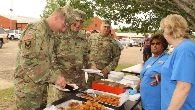 Soldiers line up for lunch during the Veterans Appreciation Day event at the National Guard Armory in Selma on Saturday.