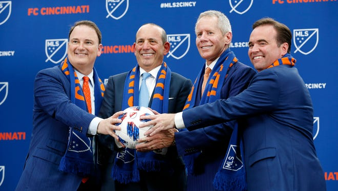 (left to right) FC Cincinnati president Jeff Berding, MLS commissioner Don Garber, team owner Carl Lindner III and mayor John Cranley pose at the conclusion of the event at Rhinegeist Brewery in the Over-the-Rhine neighborhood of Cincinnati on Tuesday, May 29, 2018. FC Cincinnati was announced as the newest expansion team to join Major League Soccer.