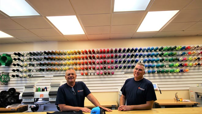 Vernon Lytle, left, and Tim Lytle get ready to start sewing things up in midtown