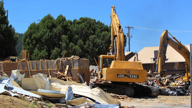 Demolition began Monday on the old Emergency Medical Services headquarters to make way for the Lincoln County Medical Center replacement hospital in Ruidoso.