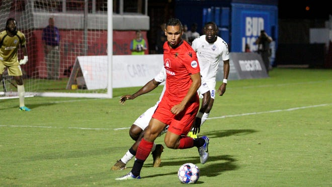 Phoenix Rising's Chris Cortez controls the ball in the box against the Colorado Springs Switchbacks FC on Saturday night at Phoenix Rising Soccer Complex on Aug. 25, 2018.