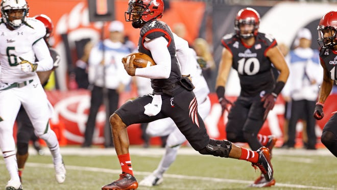 University of Cincinnati's Munchie Legaux runs for a touchdown.