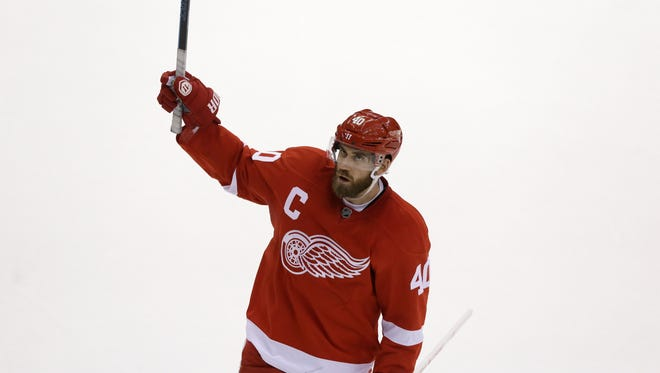 Detroit Red Wings left wing Henrik Zetterberg (40) of Sweden, acknowledges the crowd after being selected as a first star after the NHL hockey game against the Vancouver Canucks in Detroit, Sunday, Nov. 30, 2014.
