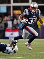 FILE - In this Saturday, Jan. 13, 2018, file photo, New England Patriots running back Dion Lewis, right, eludes Tennessee Titans cornerback Tye Smith during the first half of an NFL divisional playoff football game in Foxborough, Mass. The Patriots and the Philadelphia Eagles are set to meet in Super Bowl 52 on Sunday, Feb. 4, 2018, in Minneapolis. (AP Photo/Steven Senne, File)