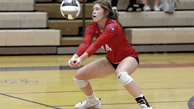 Wakaya Wilson of the Thomas girls volleyball team bumps the ball during a match against Olentangy on Sept. 15. The Cardinals were 7-2 overall and 1-2 in the OCC-Cardinal entering a league match at Hilliard Darby on Sept. 22.