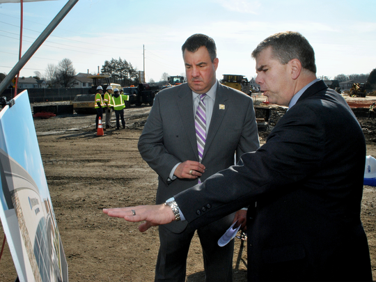 Ted Werner, chief executive officer of the Post Acute Medical Rehabilitation Hospital in Dover (right) talks with Kent County Levy Court Commissioner Jim Hosfelt about the project during the Feb. 20 groundbreaking.