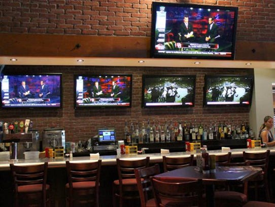 Interior of a Zipps Sports Grill. Locations Valley-wide.