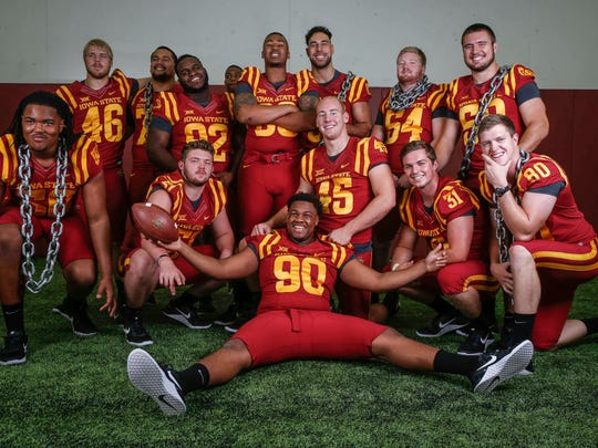 Members of the Iowa State Cyclones football team play around during a photo shoot during the Iowa State football team media day at Bergstrom Indoor Practice Facility on the Iowa State campus in Ames on Thursday, Aug. 3, 2017.