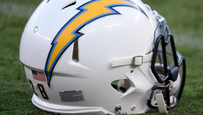 In this Sept. 1 photo, a San Diego Chargers helmet sits on the field before a preseason NFL football game against the San Francisco 49ers in San Diego.