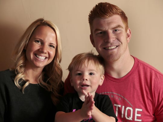 Andy Dalton is pictured with his wife Jordan (left) and son Noah.