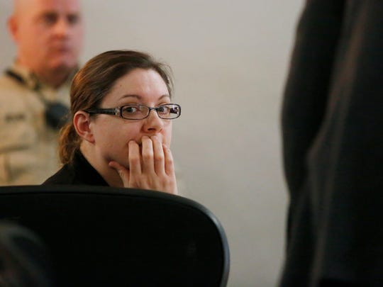 Nicole Finn looks across the courtroom Monday, Dec. 11, 2017, before her defense attorneys call their first witness during Finn's trial at the Polk County Courthouse in Des Moines. Finn faces murder and kidnapping charges in connection with the starvation death of 16-year-old Natalie Finn.