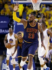 Cleveland Cavaliers forward LeBron James (23) reacts during the second half of Game 1 of basketball's NBA Finals against the Golden State Warriors in Oakland, Calif., Thursday, June 4, 2015. (AP Photo/Ben Margot)