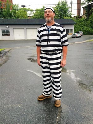 In this June 9, 2015 photo, James Lowe of Barnet, Vt., poses for a photo after a judge  told him to leave the Caledonia County Courthouse in St. Johnsbury, Vt., for wearing prison stripes and matching beanie to jury selection.